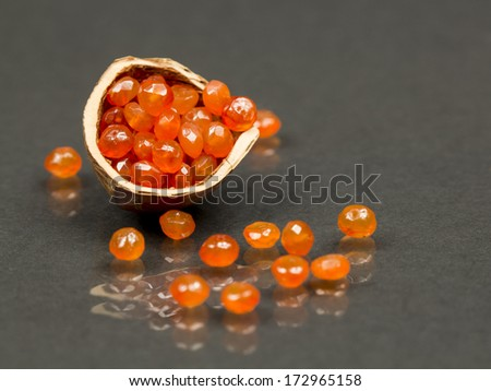 Hazelnut shell with carnelian faceted gems