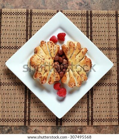 Hazelnut strudel with raspberries - stock photo