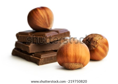 hazelnuts and chocolate isolated on white close -up  - stock photo