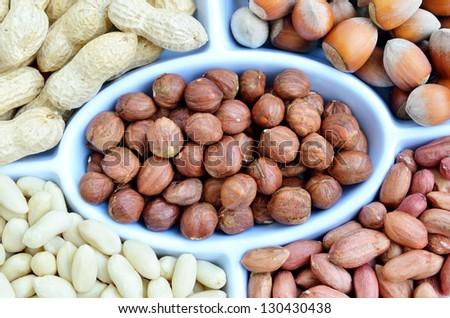 hazelnuts and peanuts - stock photo