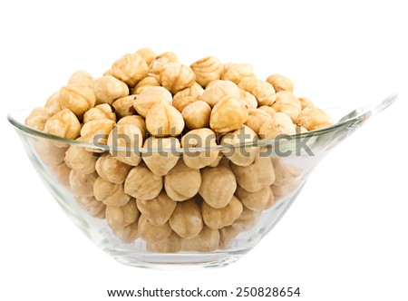 hazelnuts in glass piala. Isolation on white background . image collected from a few photos for larger areas of focus - stock photo