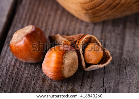 Hazelnuts on a wooden background. - stock photo
