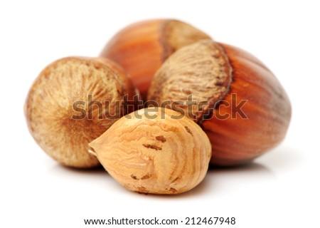 Hazelnuts on white background - stock photo