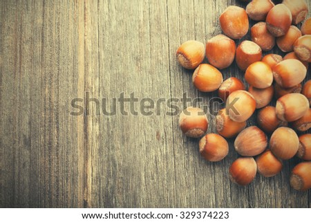Hazelnuts on wood table with copyspace