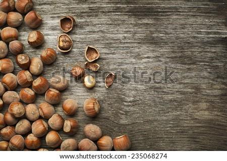 Hazelnuts on wooden background close up shoot - stock photo