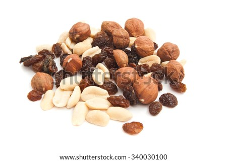 hazelnuts, peanuts and raisins closeup on white background
