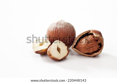 Hazelnuts whole and peeled on white background