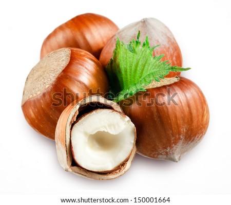 Hazelnuts with leaves on white background - stock photo