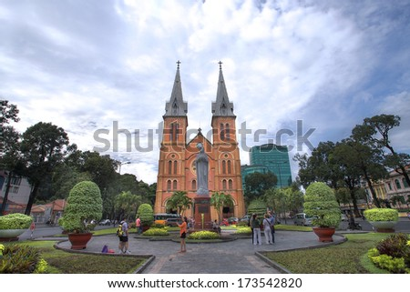 HCMC, VIETNAM-JAN. 9 2014:  Tourist visiting the notre dame cathedral in Ho Chi Minh City, Vietnam. - stock photo