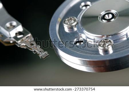 HDD - close up of computer hard disk - stock photo