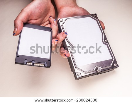 Hdd drives in hands - stock photo