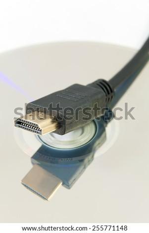 HDMI Plug and blu-ray - stock photo