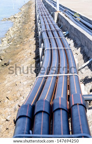 HDPE pipes beside bridge - stock photo