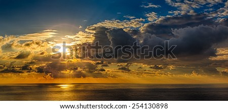 HDR Cloudy sunset over sea ocean - stock photo