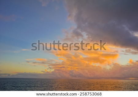 HDR Colred Sunrise Clouds over the Atlantic Ocean in Tenerife Canary Islands - stock photo