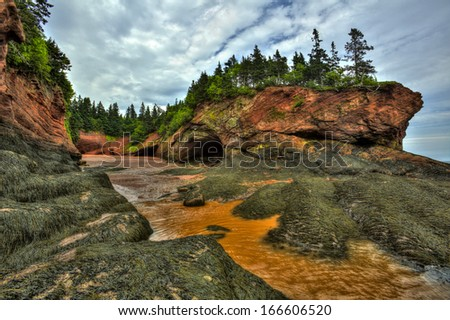 HDR (high dynamic range) image of caves and coastal features at low tide of the Bay of Fundy at St. Martins, New Brunswick, Canada.