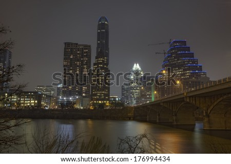 HDR image of a partial skyline of Austin, Texas over the water of Lady Bird Lake at night