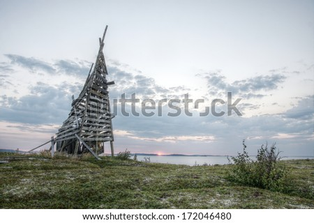 HDR image of abandoned and ruined navigation beacon on White sea shore, Russia - stock photo
