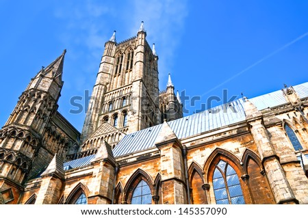 HDR image of Lincoln Cathedral, UK,  and its towers. - stock photo