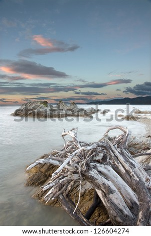 HDR image of the sea at dawn in Kaikoura, New Zealand - stock photo
