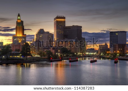 HDR image of the skyline of Providence, Rhode Island from the far side of the Providence River viewed just as the sun is setting at dusk