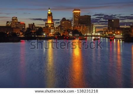 HDR image of the skyline of Providence, Rhode Island from the far side of the Providence River just after dark - stock photo