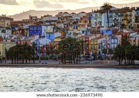 HDR image of Villajoyosa beach and colored houses, in Spain. - stock photo