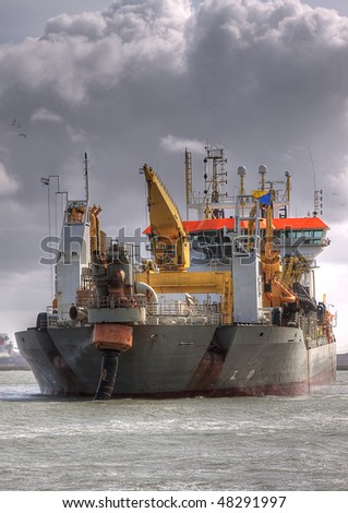 HDR of Dredger Oranje full front in port
