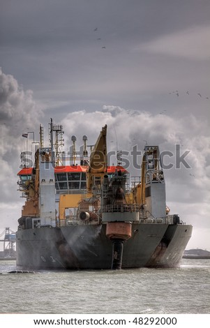 HDR of Dredger Oranje in port - stock photo