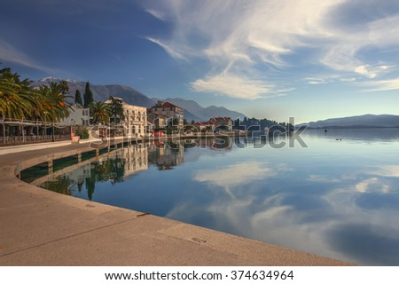 HDR photo of adriatic sea sidewalk with hotels and beautiful scenery of sky. - stock photo