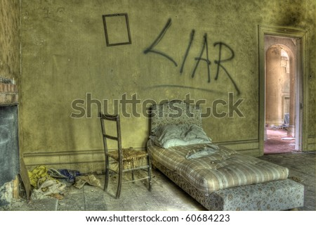 HDR photo of bed in derelict house. Graffiti against wall - stock photo