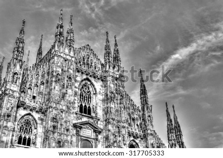 HDR photo of the famous Cathedral Duomo di Milano on piazza in Milan, Italy, during a sunny nice day