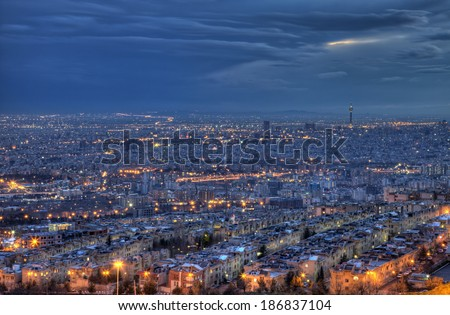 HDR shot from Tehran skyline and illuminated buildings of the city, just after sunset. - stock photo