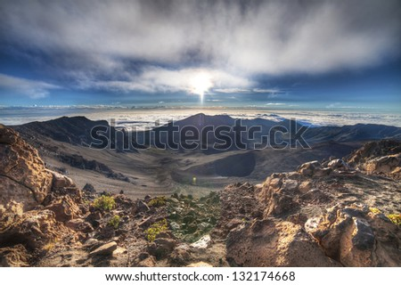HDR view from Haleakala volcano at sunrise. - stock photo