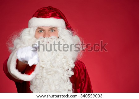 He chose you. Saint Nick pointing at the camera with his finger with his eyes wide open