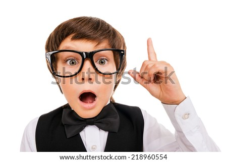 He has got an idea. Surprised young boy in bow tie and gesturing while isolated on white - stock photo