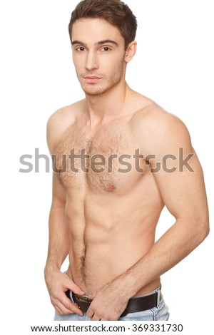 He has the body. Vertical half length portrait of a handsome muscular shirtless young man - stock photo