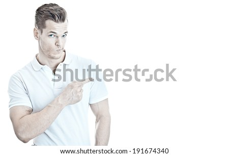 He knows what is good! - Muscular young guy pointing at empty copyspace, isolated on white background - stock photo