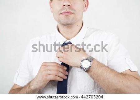 he man straightens his tie - stock photo