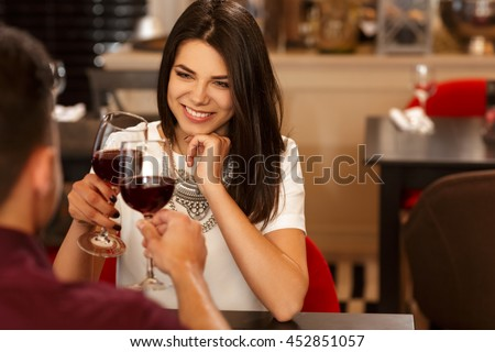 He stole her heart. Beautiful young woman toasting her wine glass with her man during a romantic date at a fancy restaurant