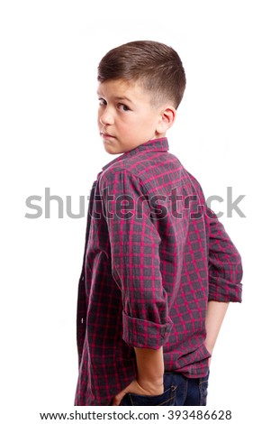 He was standing in half-turn, in the background the white background/ Portrait of a boy in a half-turn/ The teenager turned around - stock photo
