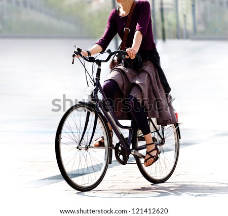 he woman on the bike after work. Urban scene. - stock photo