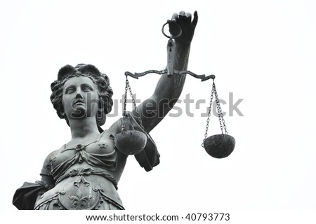 head and arm of a justice statue - stock photo