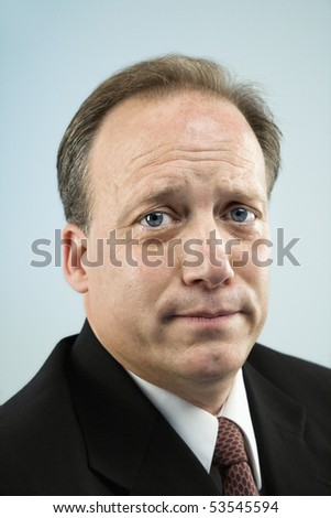 Head and shoulder portrait of middle aged  Caucasian businessman. - stock photo