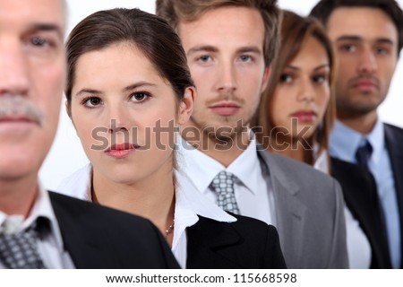Head and shoulder shot of five city workers - stock photo