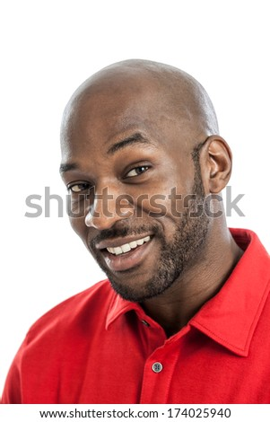 Head and shoulders close up portrait of a handsome black man in late 20s isolated on white background