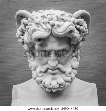 Head and shoulders detail of the ancient sculpture. - stock photo