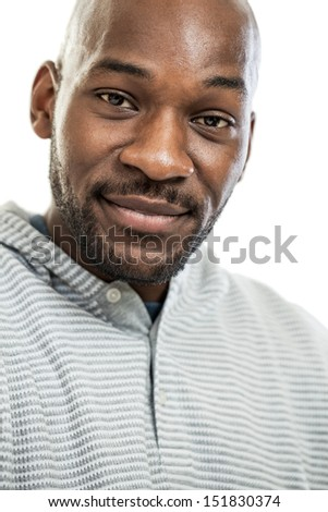 Head and shoulders portrait of a handsome African American man isolated on a white background