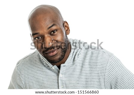 Head and shoulders portrait of a handsome black man in his late 20s isolated on white