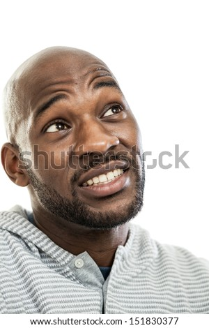 Head and shoulders portrait of a handsome black man in his late 20s isolated on white with doubtful expression